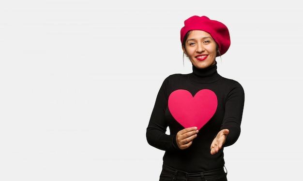 Jeune femme à la saint valentin tendre la main pour accueillir quelqu'un