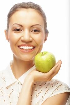 Jeune, femme, vert, pomme, isolé, blanc