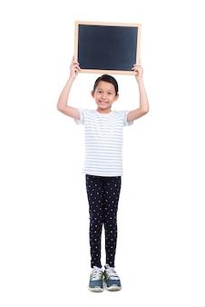 Jeune, fille asiatique, tenue, tableau, et, sourires, sur, fond blanc