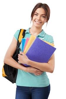 Jeune fille étudiante avec sac à dos et livres