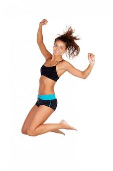 Jeune fille sautant avec sportwear isolé sur fond blanc
