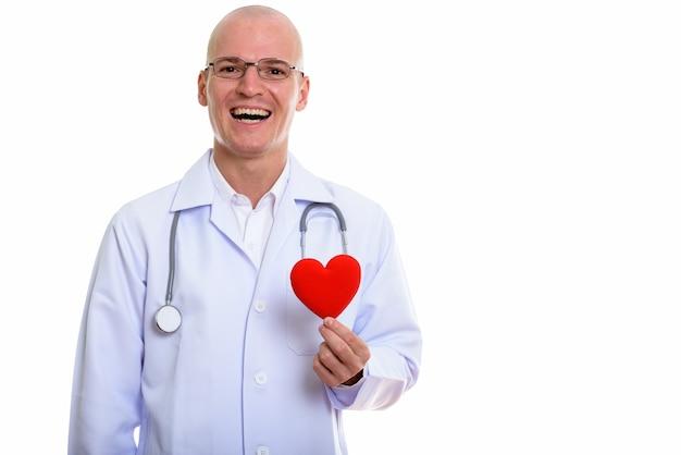 Jeune, heureux, homme chauve, docteur, sourire, quoique, tenue, coeur