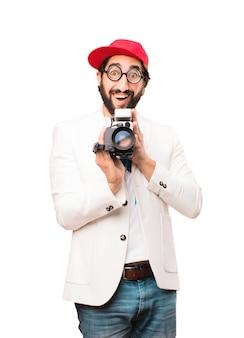 Jeune homme d'affaires fou avec une caméra de cinéma