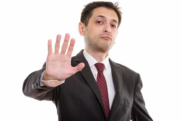 Jeune homme d'affaires avec panneau d'arrêt