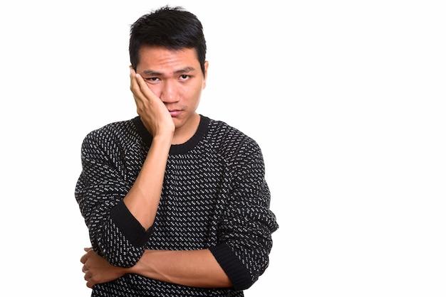 Jeune homme asiatique à la recherche de stressé