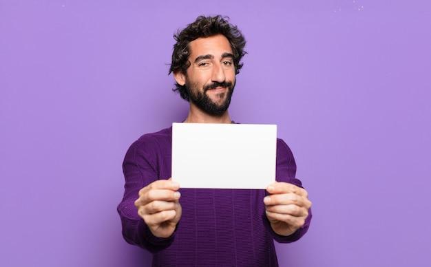 Jeune homme barbu avec une bannière vierge