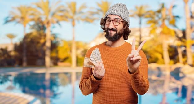 Jeune homme barbu avec des billets