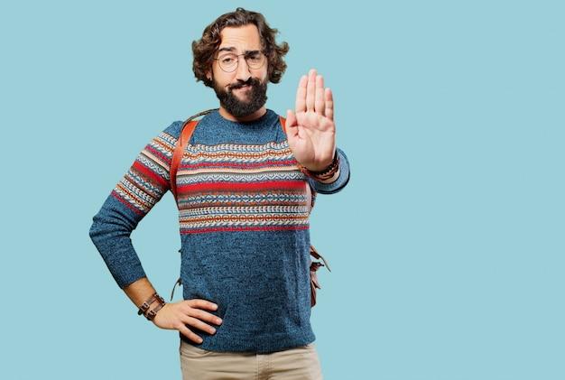 Jeune homme hippie arrêter le geste