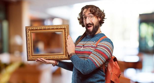 Jeune homme hippie au cadre baroque