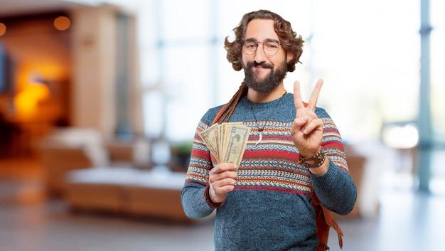 Jeune homme hippie avec des billets