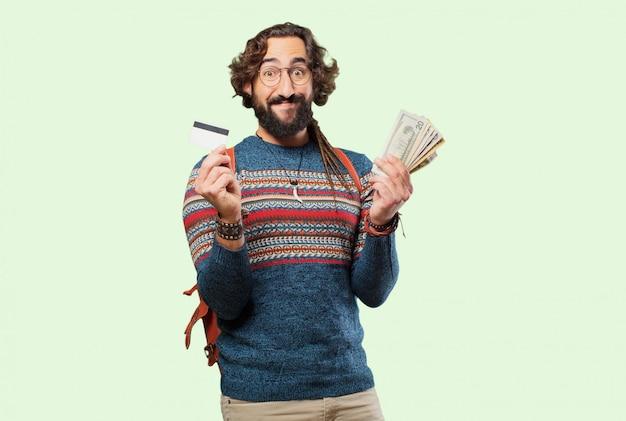 Jeune homme hippie avec une carte de crédit