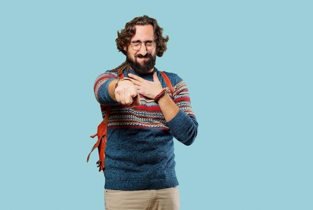 Jeune homme hippie pointant