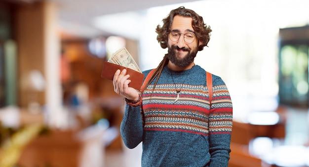 Jeune homme hippie avec un portefeuille
