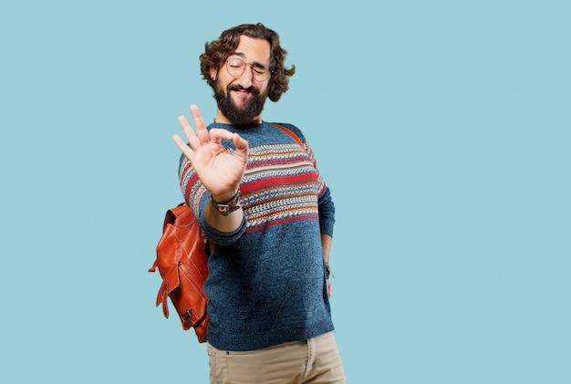 Jeune homme hippie signe d'accord ou d'accord