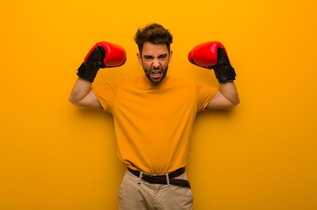 Jeune homme, porter, gants boxe
