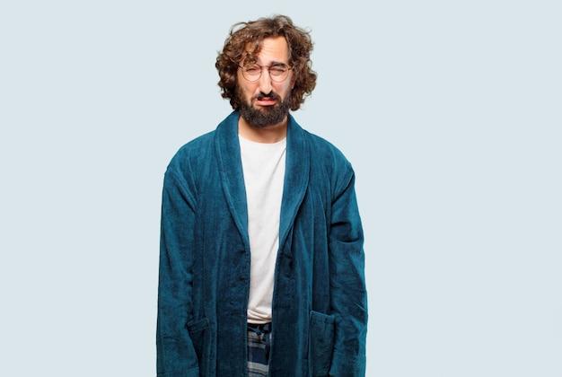 Jeune homme, porter, peignoir, nuit, costume, pose triste