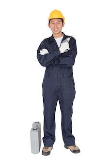 Jeune homme à tout faire debout avec sa boîte à outils