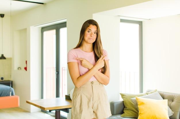 Jeune jolie femme à la perplexité et à la confusion