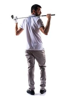 Un jeune jouant au golf de loisir