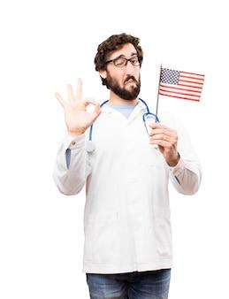 Jeune médecin avec drapeau