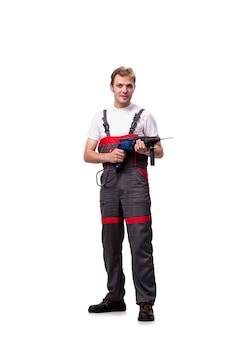 Jeune réparateur avec perforateur isolé sur blanc