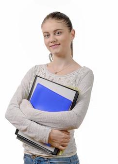 Jolie étudiante heureuse avec ses études sur fond blanc
