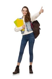 Jolie étudiante tenant des manuels isolés sur blanc