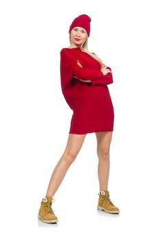 Jolie fille en robe rouge isolé sur blanc
