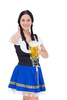 Jolie oktoberfest girl tenant le chope de bière