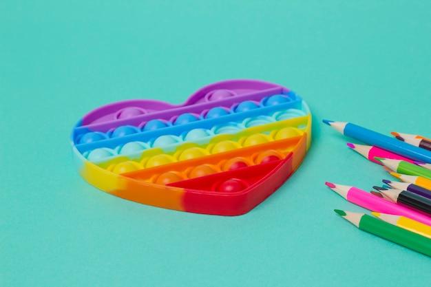Jouet anti-stress pop it en silicone coloré