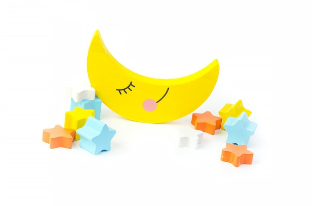 Jouet de développement pour enfants pour le développement de la motricité, un croissant de lune avec des étoiles, sur fond blanc.