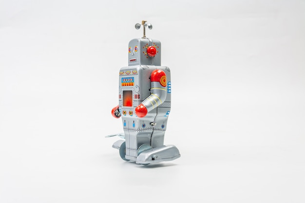 Jouet étain robot sur fond blanc