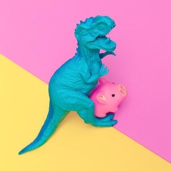 Jouets de dinosaure et de cochon sur fond coloré. art minimal à plat.