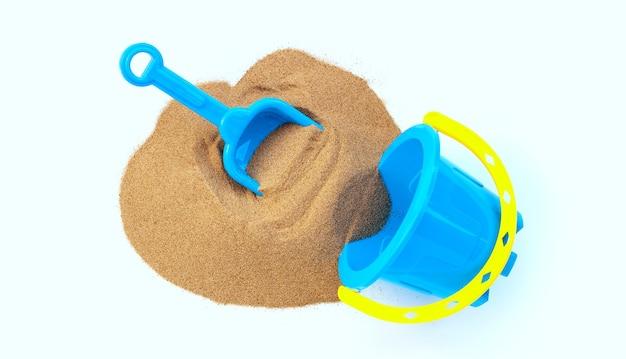 Jouets en plastique, pelle et seau avec du sable sur une surface blanche