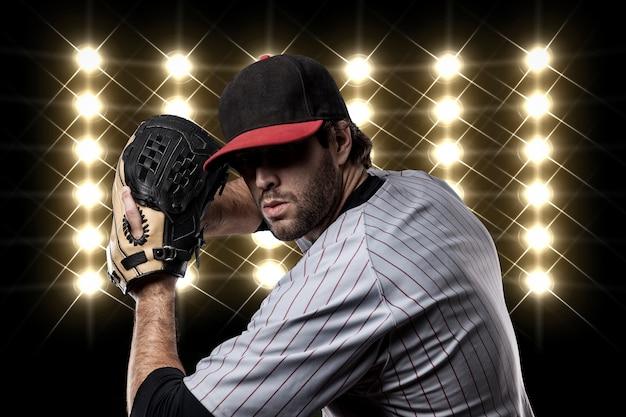 Joueur de baseball devant les lumières.