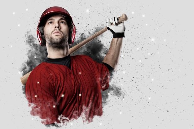 Joueur de baseball avec un uniforme rouge sortant d'une explosion de fumée.