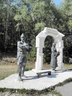 Joueur de cornemuse sculptures en bronze et la femme vient