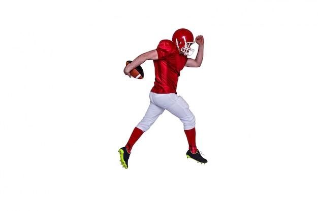 Joueur de football américain en cours d'exécution avec le ballon