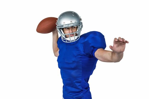 Joueur de football américain lancer la balle