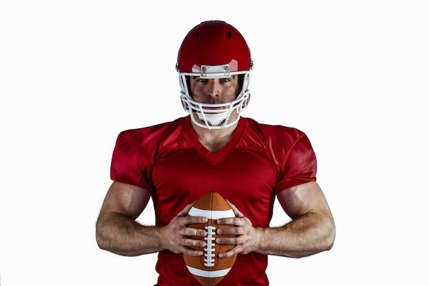 Joueur de football américain tenant la balle
