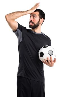 Joueur de football ayant des doutes