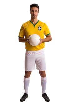 Joueur de football brésilien, célébrant sur un espace blanc.