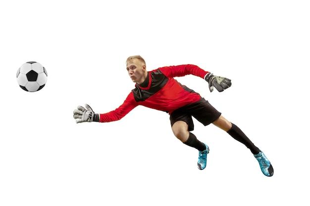 Joueur de football masculin gardien de but attraper le ballon en saut silhouette d'homme en forme avec ballon isolé