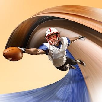 Un joueur masculin de rugby caucasien isolé sur fond jaune. prise de vue en studio d'un homme en forme en mouvement ou en mouvement avec une balle. concept de saut et d'action. une tension incroyable de toutes les forces. conception abstraite.