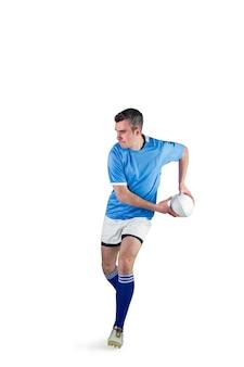 Joueur de rugby faisant une passe latérale