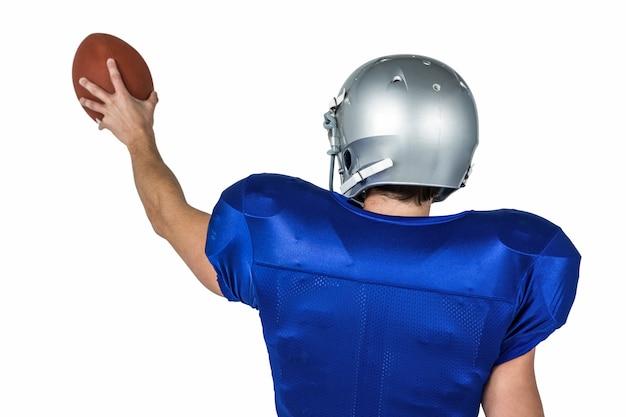 Joueur de sport tenant le ballon