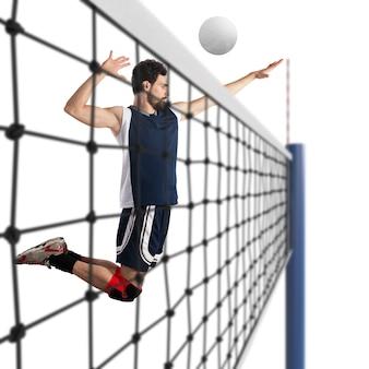 Le joueur de volley-ball frappe la balle en sautant