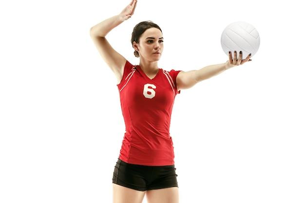 Joueur de volley-ball professionnel féminin isolé sur blanc avec ballon