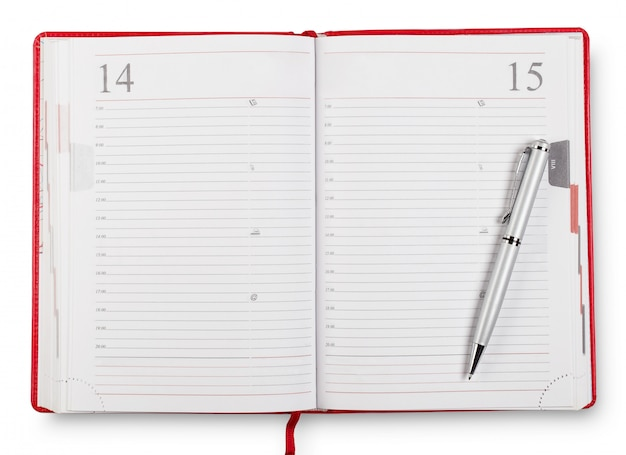 Journal ouvert rouge avec stylo
