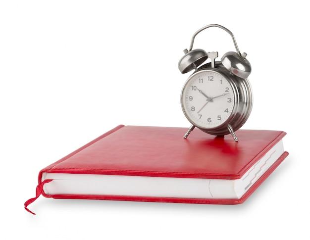 Journal rouge et vieux réveil